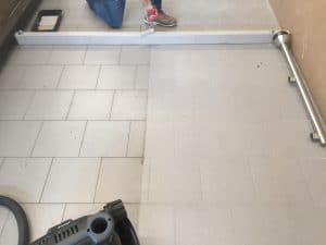 Maintenance Division at Eleven Western Builders cleaning grocery store floor.